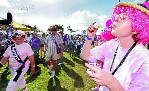 Judith Nicholson, from Wendy's Allenstown Lively Kids Walk, blows bubbles as cancer survivors do a lap of the Cancer Council's Relay for Life circuit on Saturday afternoon.