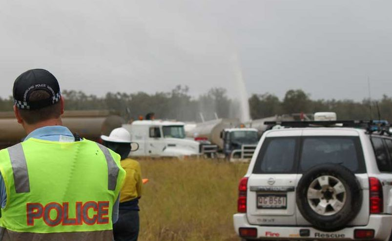 Police stand guard at the gas well leak near Dalby.