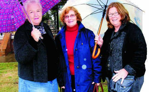 (From left) Philomena Aspinall, Suzanne Ridley and Dorothy Haig had their brollies at the ready before yesterday's historic coach tour.