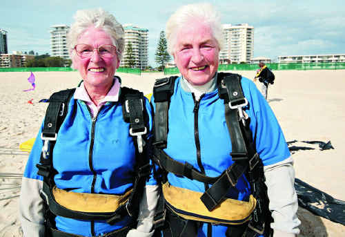 Sisters Leola Hull, 74, and Dulcie Anderson, 73, took the plunge over Kirra Beach on Monday.