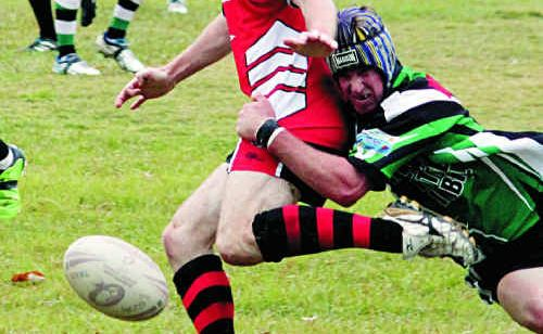 The Stags' Josh Ryan takes down a Palmwoods player in May.