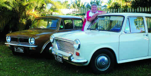 Classic's By The Coast organiser Kev Hogan with his pride and joy, a 1964 Morris 1100 sedan and 1978 Leyland Mini 1275 LS.
