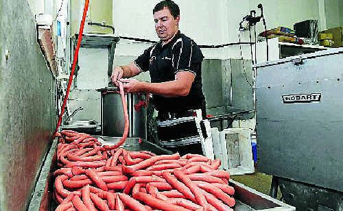 Nathan Scully, a butcher at Smith's Butchery in Casino, with some of the 400kg of sausages prepared for tomorrow free Beef Week breakfast.