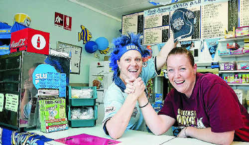State of Origin fans Rebecca Ford and Kristie Payne showing their colours at the Park Avenue Mall Snack Bar.