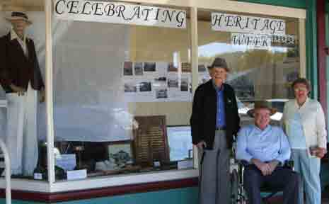 Allora sporting identities Keith Masters, Ken Telford & Heather Slatter recalling days of past glories as they take in the Heritage Week display in Allora.