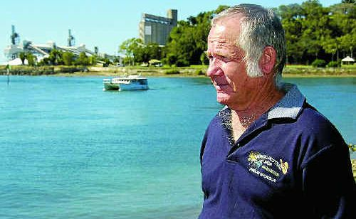 Clive Last, pictured at Gladstone Marina, was shocked to discover a dead dolphin washed up on Turtle Island.