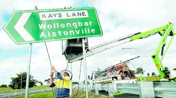 Workers put the finishing touches to the Alstonville bypass before today's official opening.