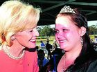 Governor-General Quentin Bryce congratulates Samantha Stevenson for her fundraising efforts at the official opening of the show yesterday. The showgirl entrants raised $40,000 between them.