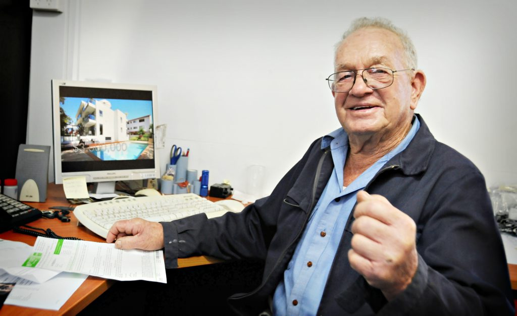 Popular Gympie businessman Noel Atkinson checks out an internet image of the Gold Coast apartment complex he has just won in an RSL lottery.