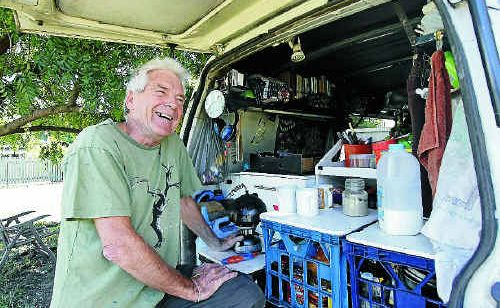 Peace campaigner Graeme Dunstan makes a brew in the back of his Peacebus from where he is co-ordinating protests against operation Talisman Sabre.