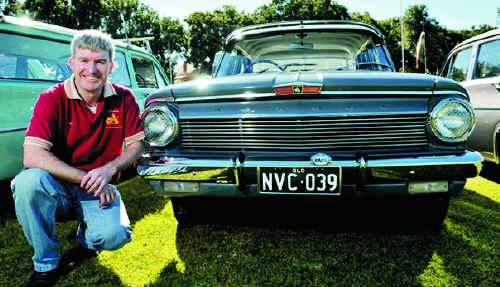 Toowoomba FX and FJ Holden Club president Jim Dwan shows off his EJ Special at the club's photo shoot on Saturday.