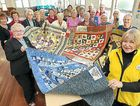 Vice-president Denise Smith (right) and members of the Hervey Bay Quilters Group make quilts for wounded war veterans at the John Paul Centre.