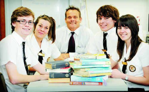 James Nash State School principal Darrin Edwards (centre) is proud of his school's achievements in the 2010 Year 12 Outcomes Report. Mr Edwards is pictured with his 2011 leadership team (from left) school captains Dean Langton, Claire Powell and Shaun Ringuet, and Student Representative Council president Kirsty Kent.