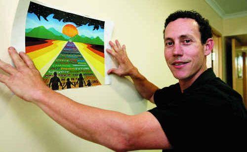 Matthew Humphries displays his award-winning artwork, Road To Change.