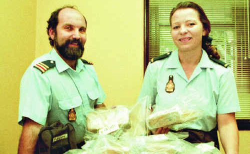 Customs officers Diane Brentt and Tony Scicluna with drugs seized at Hay Point in June, 1996.