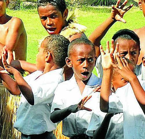 Fijian children sing and dance.