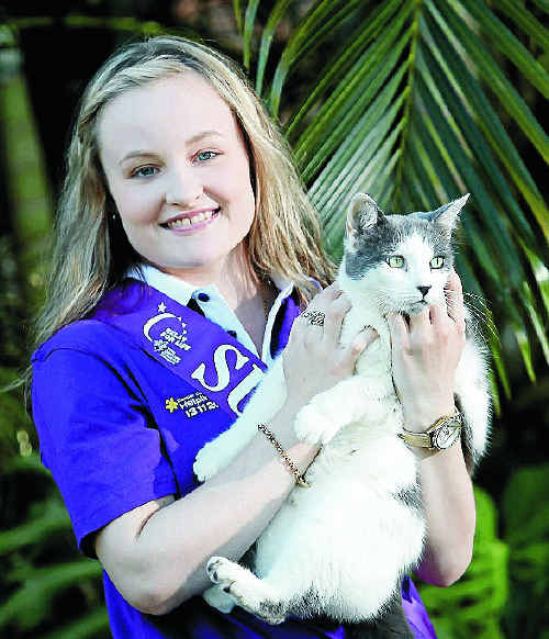 Inspirational 18-year-old Relay for Life cancer survivor Mikaela Ryan with her cat Pepper.