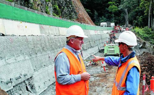 District director for the Department of Transport and Main Roads Paul Noonan and Fulton Hogan senior project engineer Murray Thomas.