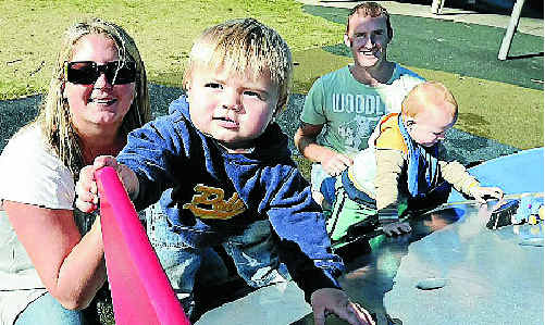 Enjoying the sunshine in Lennox Head on the first day of winter are Larissa Cartwright and her son Finn, 1, and Andy Newton and his son Banjo, 14 months.