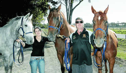 Stablehand Jackelyn Johnston with local trainer Jason Brown, who has three horses, (from left) Easy Cash, Shy Devil and Tantat Secret, in the XXXX Gold Newmarket Day Open Handicap (1400m) at Callaghan Park today.