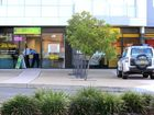 Police investigate at The Cash Store on Wharf St after an attempted armed robbery.