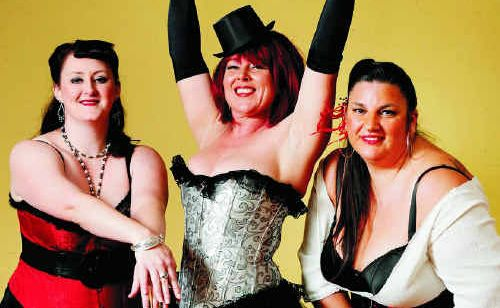 Dancing Tiger Studio dance teachers from left, Crystal Graham, Rachelle Houston and Sue McGee demonstrate a burlesque performance.