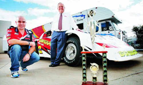 Queensland Super Sedan series winning driver Darren Kane (left) celebrates his success (in the Mazda RX8 Dominator) with racing team owner Ian Boettcher.
