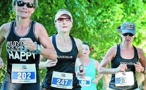 Kim Bennett, Yolanda Hanson and Sam Harpher compete in last year's half marathon.