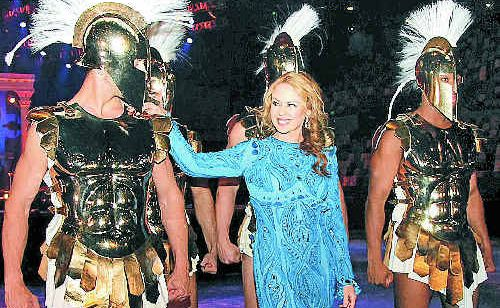 Pop princess Kylie Minogue checks out the male muscle before her shows tonight and tomorrow night at the Brisbane Entertainment Centre.