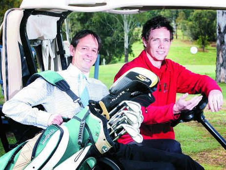 Ipswich Golf Club general manager Brett Holdway (right), seen here with golf shop assistant Paul Brown, is to quit the club.