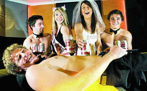 Mitchell Orr (front) with Nick Ivey and Rhys McNaughton serving drinks to Thalia Kilpatrick and Alyson Elliot at a Bridal Fair promotion.