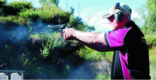 A local pistol shooter keeps a close eye on the target at the Emerald range.