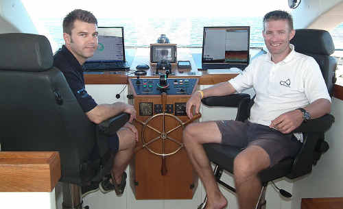 Captain Erwann Le Rouzic and Raphael Domjan aboard the solar vessel Turanor on Saturday.