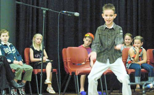 Lee Pagotto, 8, recites his version of a poem titled The Crazy Teacher Show by Bruce Lansky at the Gift of the Gab competition in Alstonville yesterday.