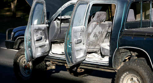 The interior of the Toyota HiLux is covered in white residue after a home-made device inside the car exploded as it was being driven along Keeleys Road on Saturday afternoon.