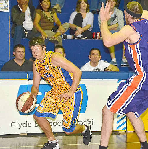 Port City's Dale Iwanicki looks for a way around Maroochydore's Steve Waubdy during the Port City Power versus Maroochydore Clippers men's basketball match at the Kev Broome Stadium on Saturday night.