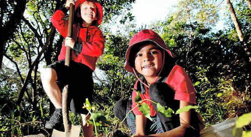 Fingal Head Public School students Sam Jacobson and Ashi Hilmer planting vines for butterflies.
