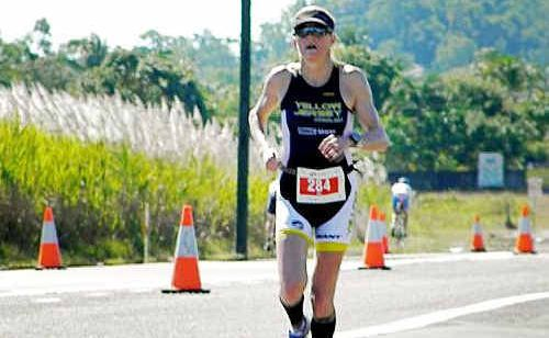 Fearless Ipswich competitor Kym Jaenke stays focused during the gruelling marathon leg of Sunday's ironman event in Cairns.
