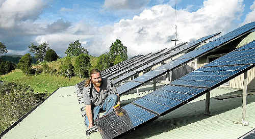 """Nimbin Rainbow Power Company co-director John Davis fears the NSW Coalition Government appears to hold the out-dated view that the only people interested in solar power are """"hippies and inner-city yuppies""""."""