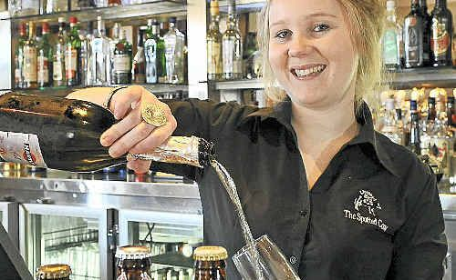 Bartender Caitlin Campbell shows off the pub's beer variety and the now popular white wine.