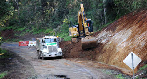 Works continue to fix Amamoor Creek Rd. It was washed away during January's flood; about 30% of the road has been repaired and the council hopes to have it open by next month.