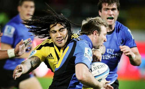 """Ipswich product James Stannard gives Ma'a Nonu """"the don't argue"""" before sending Ben McCalman (in support) over to score for the Western Force against the Hurricanes in their recent Super 15 clash. Photo: Getty Images"""