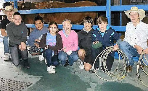 Clown Harley Baker, Seven Hills State School students Ruby MacGregor, Rain Langi, Lily Sadiq, Ella Clark, Mael Thebaud, Harry Cross and roper Tim Burraston at the Australian Rodeo Heritage Centre.