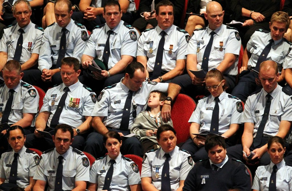A moment from the funeral of Det Sen-Const Damian Leeding in 2011.
