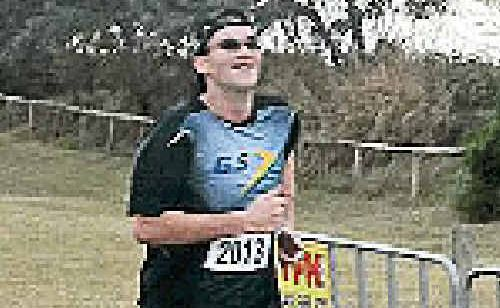 Cameron Owens hits the finish line in an 8km race, part of the BMA Mackay Marina Run.