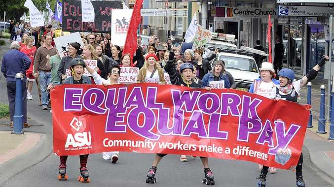 Protesters march through Lismore's CBD rallying for equal pay for community workers.