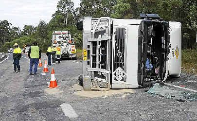 A B-double truck which rolled on the Pacific Highway about 2km south of the New Italy complex at Tabbimoble . The woman driver was taken to Lismore Base Hospital by ambulance with what was believed to be minor injuries.