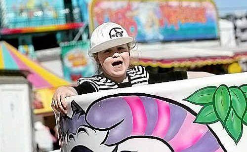 Imogen Hiscox enjoys a ride at last year's Yeppoon Show.