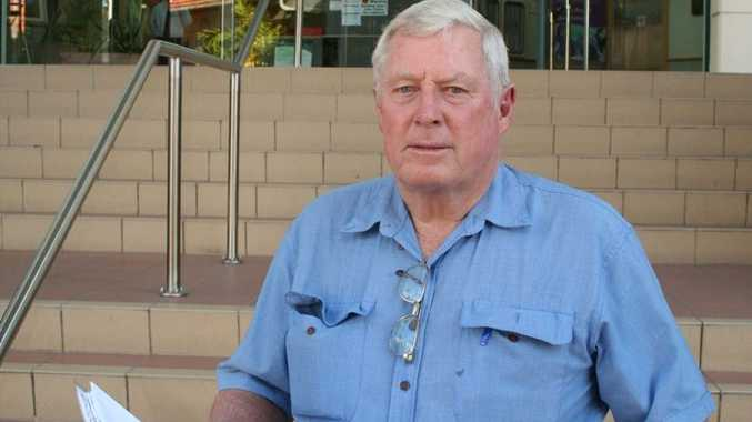 Rockhampton businessman Peter Boyle stands outside of the Rockhampton courthouse after he appeared in court for refusing to pay rates.