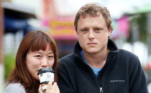 Yumi Fujimoto and Patrick Kluz search look for coffee and closeness as they brave the cool weather.